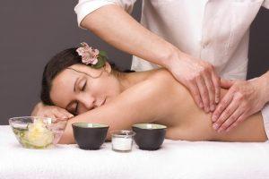 masseur gettins massage beautiful young woman